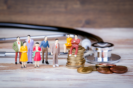 Medical care and expenses, health insurance. Colorful Human miniatures. Standard-Bild