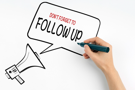 objections: Dont Forget to Follow Up. Megaphone and text on a white background. Stock Photo
