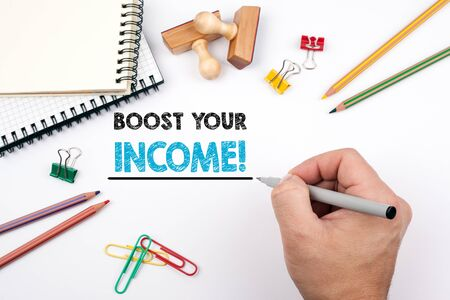 boost your income. White office desk on which various items. Stock Photo