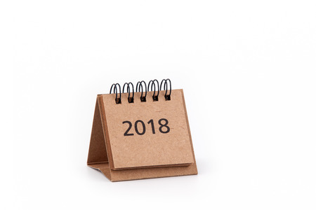 2018 Cardboard calendar on a white background. Free text space.