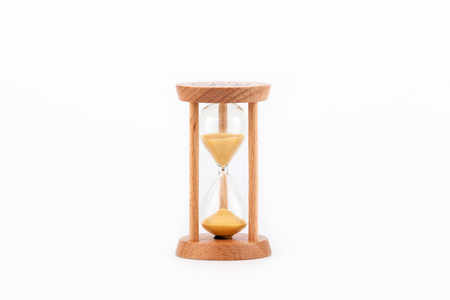 Sandglass, hourglass or egg timer on white table showing the last second or last minute or time out. Banque d'images