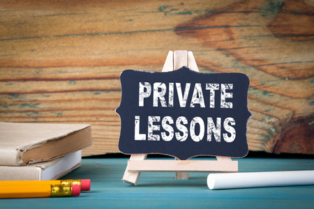 Private Lessons, education concept. small wooden board with chalk on the table. Stock Photo