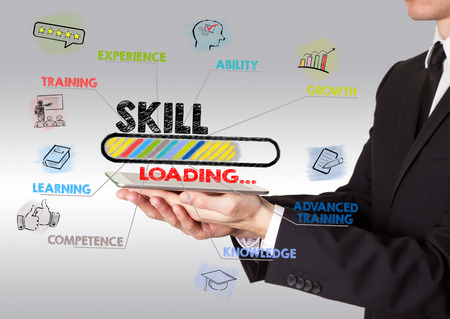 skill concept, young man holding a tablet computer.