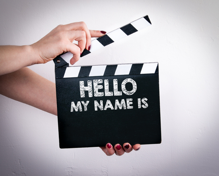 Hello My Name Is. Female hands holding movie clapper.