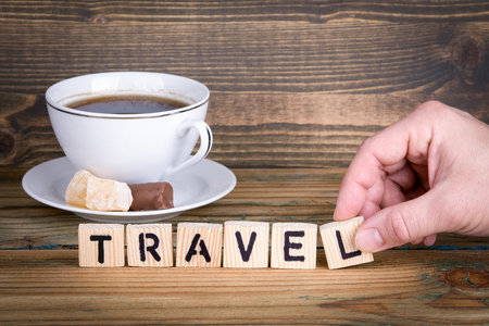 travel. Wooden letters on the office desk, informative and communication background. Stock Photo