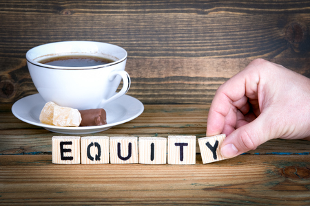 equity. Wooden letters on the office desk, informative and communication background. 스톡 콘텐츠