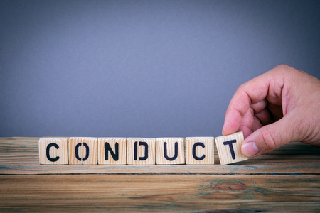conduct, wooden letters on the office desk, informative and communication background
