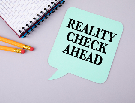 Reality Check Ahead concept. Paper speech bubble.