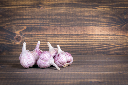 Garlic on a wooden Halloween background with copyspace