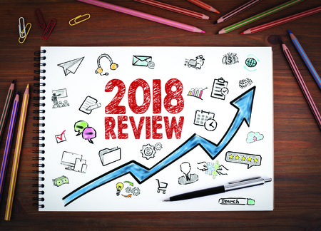 2018 review, Business Concept. Notebooks, pen and colored pencils on a wooden table. Reklamní fotografie
