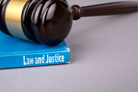 Law and justice concept. blue book on a gray office table. communication and information