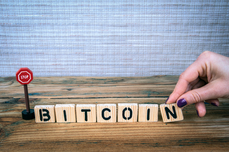 bitcoin concept. Wooden letters with road sign, informative and communication background Foto de archivo