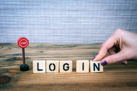 Stop log in concept. Wooden letters on the office desk, informative and communication background