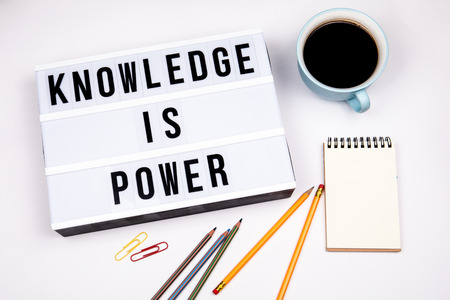Knowledge is power. Text in lightbox. White desk with stationery Banco de Imagens - 119005555