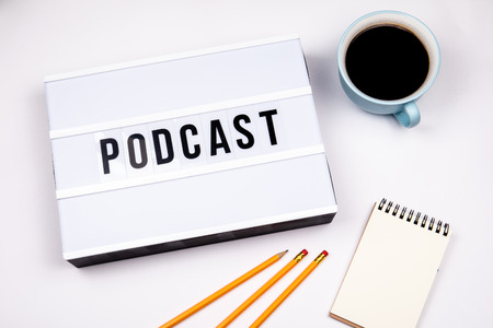 Podcast, Text in lightbox. White desk with stationery