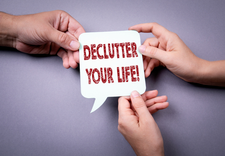 Declutter your life. Speech bubble on a gray background