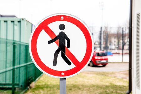 Road sign prohibiting the movement of pedestrians.