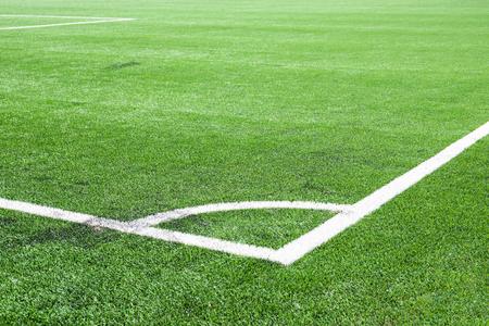 White line corner on the green soccer field.