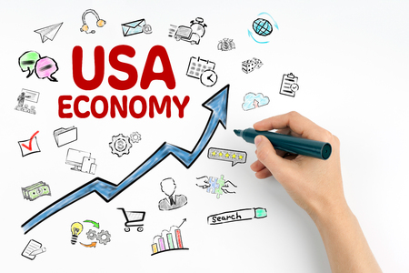 USA Economy Concept. Hand with marker writing