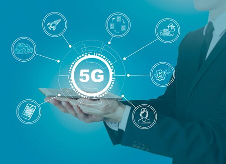 5g network, high-speed mobile Internet. Science, education, business and health concept. Man holding a tablet computer Stockfoto