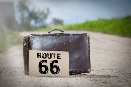 Route 66. Old traveling suitcase on country road