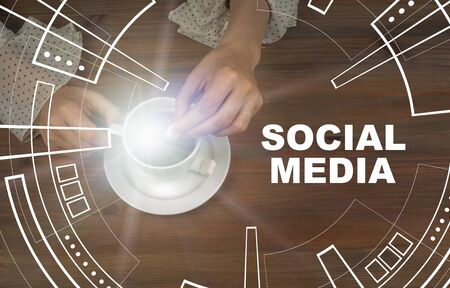 Social Media concept. Coffee cup on wooden table background Stock Photo - 125886828
