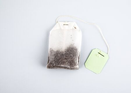 Teabag with green label. Top view, on a white background. mockup Stock Photo - 125886838