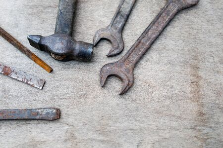 Different construction and hand tools on wooden board, maintenance and reparing concept Stock Photo - 125886814