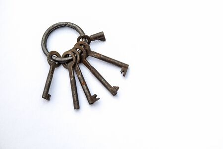 Bunch of different keys on a white background. New housing, property and mortgage loan concept. Copy space Stock Photo - 125886792