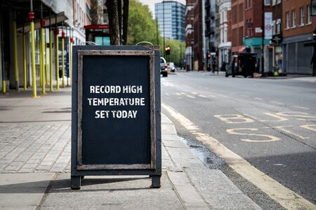 Record high temperature set today. Foldable advertising poster on the street