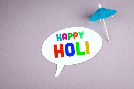 Happy Holi. Speech bubble on a gray background