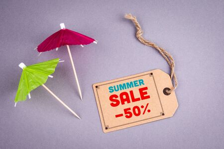 Summer sale 50 percent off. E-commerce concept,  blank price tag on a gray background Stockfoto