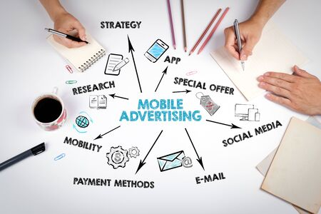 Mobile Advertising Concept. The meeting at the white office table Stockfoto