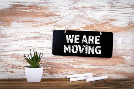 We Are Moving. Small blackboard on the wall with text, positive thinking and looking forward concept Stock fotó