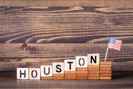 Houston United States. Politics, economic and immigration concept. Wooden letters and flag on the office desk