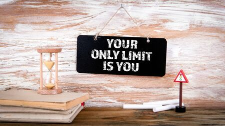 Your Only Limit Is You. Small blackboard on the wall with text, positive thinking and looking forward concept