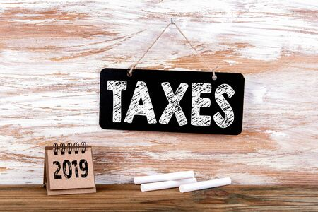 2019 taxes concept. Small blackboard on the wall with text