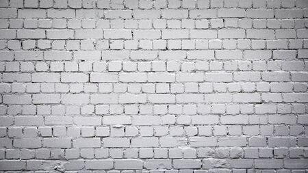 Gray brick wall background with space for your text and picture.