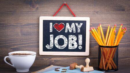 I love my job. Chalkboard on a wooden background 版權商用圖片