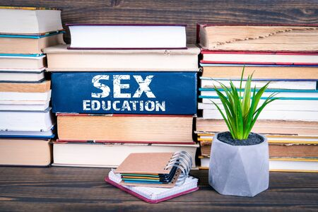 Sex Education concept. Books stacked on a wooden table 版權商用圖片