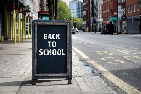 Back to School. Foldable advertising poster on the street