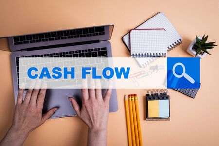 Cash Flow concept. Laptop and stationery on the office desk