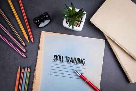 Skill Training concept. Notebook and pen on gray desk. Business and educational background Stock Photo