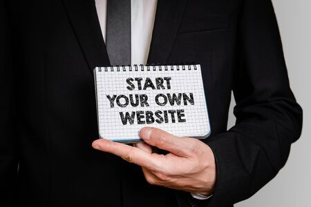 Start Your Own Website. Business man with a notepad. 写真素材