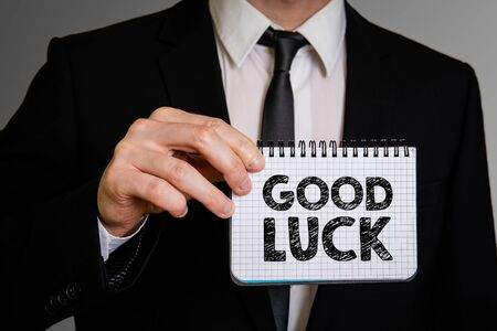 Good Luck. Positive, motivating and inspiring concept. Business man with a notepad Фото со стока