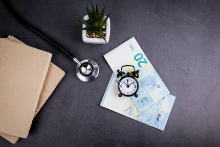 Euro money and stethoscope on concrete table. Medicine, health care and insurance concept Banco de Imagens