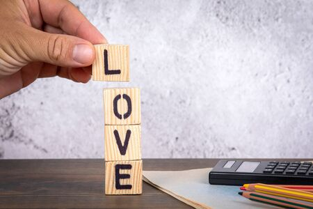 Love. Relationships and Hobbies concept. Wooden letters on the office desk