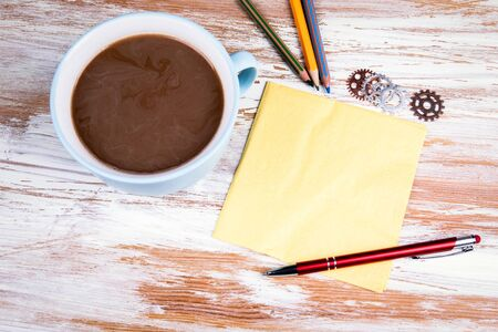 Napkin, pen and a cup of coffee. Free space for text, copy space