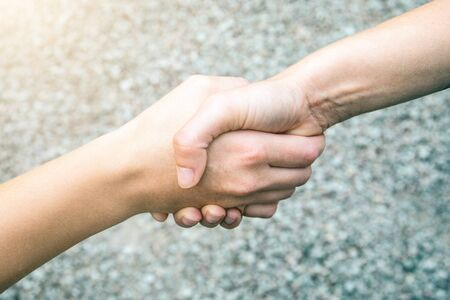 Handshake. People shaking hands, finishing up a meeting, Success agreement negotiation concept