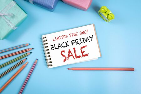 Black Friday Sale, Limited Time Only. Notepad with text, blue background